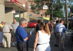 July 25, 2012: Senator Fontana speaks with a resident at the Communities Against Crime initiative