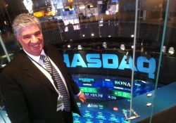 December 2011: Senator Wayne D. Fontana stands on the NASDAQ floor while in New York attending PA Society.